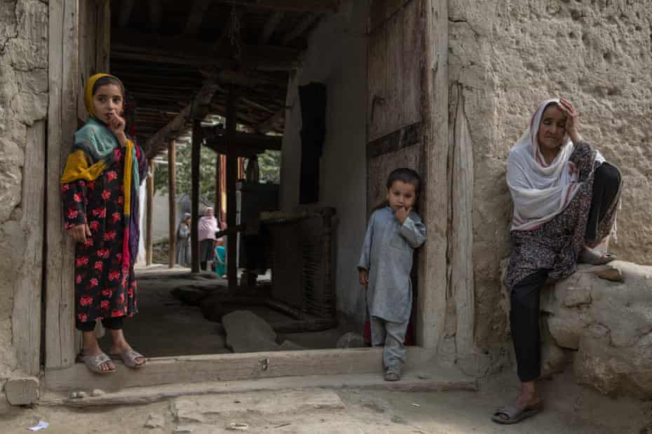 Janwaro, 50, mother of Aziz Rahman, 37, killed in a US drone strike targeting an IS-hideout but accidentally hitting pine nut farmers. At least 30 died, 40 were injured. Janwaro sits outside the family's home in Javari village, Khogyani, Nangarhar.