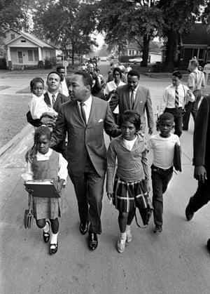 King escorts black schoolchildren to a formerly all-white school in Grenada, Mississippi, in 1966.