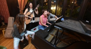 Communal HousingResidents and friends sing and play instruments in the living room of Euclid Manor, a 6,200 sqft co-living house with 11 roommates in Oakland, California on March 13, 2016. The commune's residents maintain a theme of social impact, creativity and positive change.