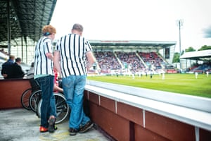 Football fans don't always wear their team's current strip. Shirts from previous seasons and eras are always a favourite with the supporters, such as these at Dunfermline Athletic.