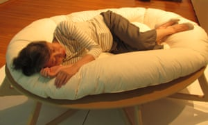 Megumi Kaji of the Research Association of Sleep and Society takes a nap on the humankind evolution bed.