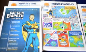 A Superhero style ad is displayed with Covid-19 comics at the El Sol Neighborhood Education Center for arrivals to a Covid-19 superhero themed play in San Bernardino, California.
