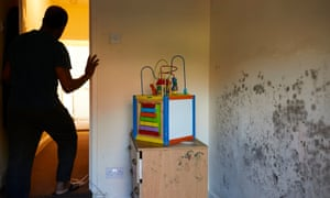 A child's toy sits next to a mouldy wall where Duminda lives with his wife and two young children in damp, conditions at a G4S house in Coventry.