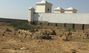 The partially destroyed graveyard in Usman Allah Raki Goth.