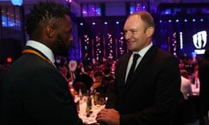 South Africa's 1995 World Cup-winning captain Francois Pienaar congratulates his triumphant successor Siya Kolisi.