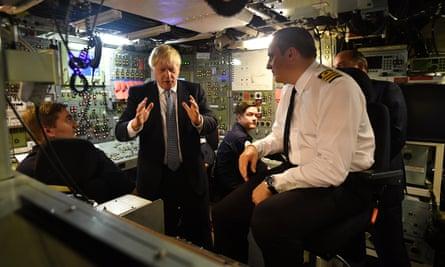 Boris Johnson meets crew members as visits HMS Victorious at HM naval base Clyde in Faslane, Scotland.