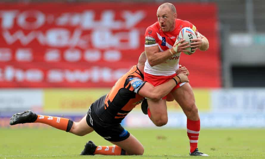 Castleford's Liam Watts tackles St Helens' James Roby