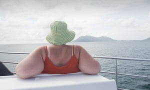 A woman on a reef cruise off Cairns, Queensland, Australia.