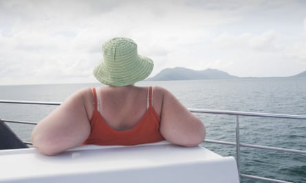 An overweight woman on a boat