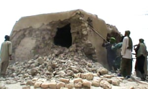 Islamist militants destroying an ancient shrine in Timbuktu.