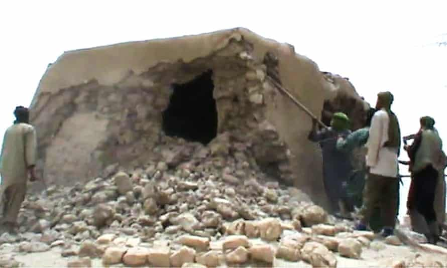 Islamist militants destroying an ancient shrine in Timbuktu.