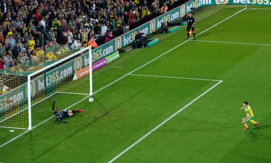 Liverpool's Caoimhin Kelleher saves Christos Tzolis's penalty.