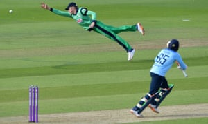 Ireland's Harry Tector (left) just fails to reach a shot from England's Adil Rashid.