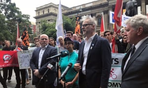 Tony Sheldon, at microphone, the TWU's national secretary, said the delivery companies were consistently 'failing to address the concerns of riders'