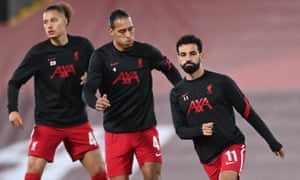 Liverpool's Mohamed Salah (right) and Virgil van Dijk (centre) warm up alongside Rhys Williams.