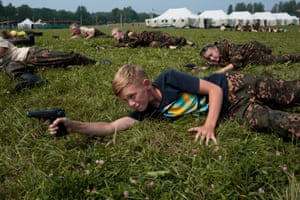 Firearm training at The Historical War Camp in Borodino, Russia. Borodino is famous for a battle fought on 7 Sep 1812 - the deadliest day of the Napoleonic Wars. 350 adolescents are in attendance, ranging in ages from 11 to 16. They are using air-soft guns for the practice and competition. The camp teaches information about the basic kinds of weapons, bases and firing rules, sniper rifles, and different type of weapons.