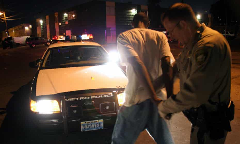 A police officer searches a suspect in Las Vegas.