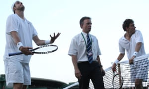 """Referee Soeren Friemel, centre, calls off the epic men's singles match between John Isner of the US, left, and Nicolas Mahut of France,because of bad light, at the All England Lawn Tennis Championships at Wimbledon, Wednesday, June 23, 2010. (AP Photo/Alastair Grant)"""