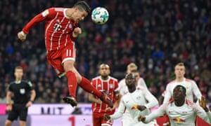 James Rodríguez rises highest for a header during Bayern's win over Leipzig in the Bundesliga.