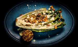 Grilled hearts of romaine with chilli pumpkin seeds.
