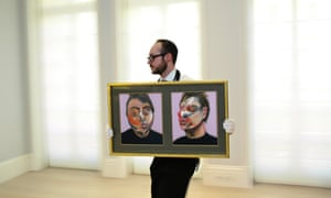 An art handler moves Francis Bacon's Two Studies for a Self-Portrait