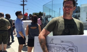 Jeremy Cross displays his purchase outside the Boring Company's HQ in Los Angeles.