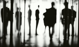 Silhouettes of office workers in the corridor of a business centre