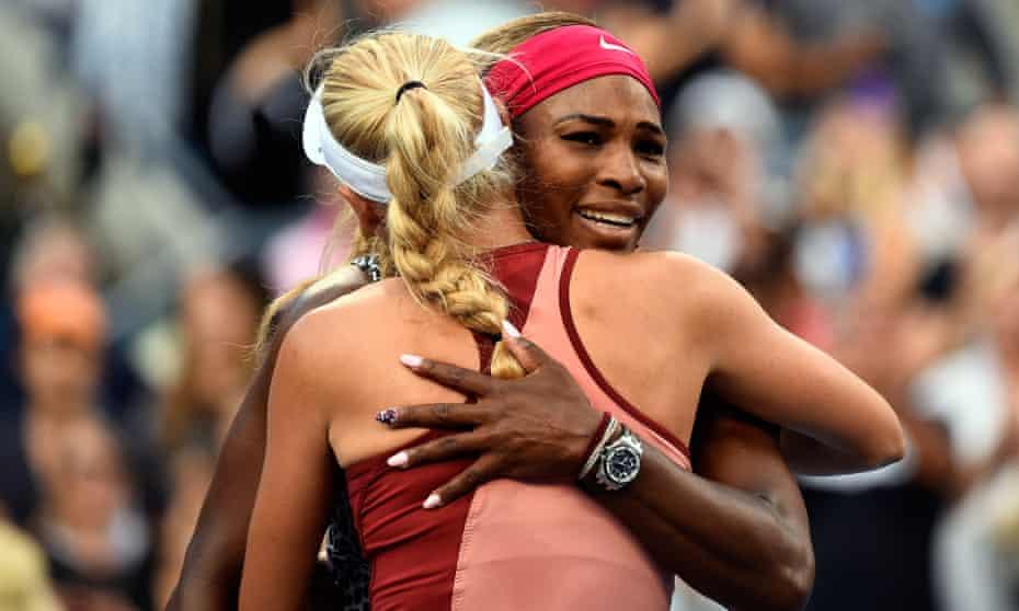 Serena Williams hugs Caroline Wozniacki at the 2014 US Open