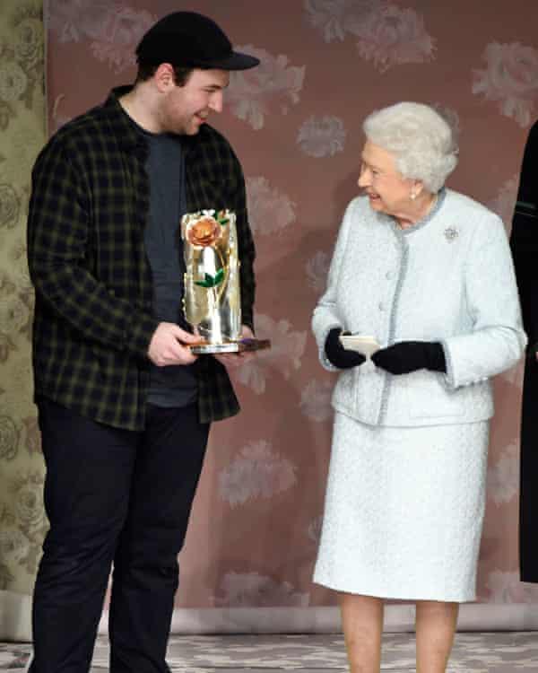 Richard Quinn receives his award from the Queen.