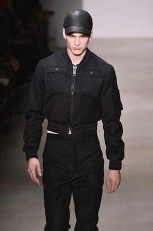 A model presents Calvin Klein's bomber jacket-centric autumn/winter 2015 collection.