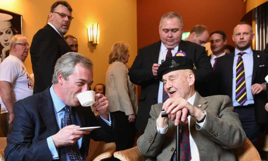 Nigel Farage has a cup of tea with World War II veteran William Curtis after giving a speech on defence at Himley Hall, near Dudley.