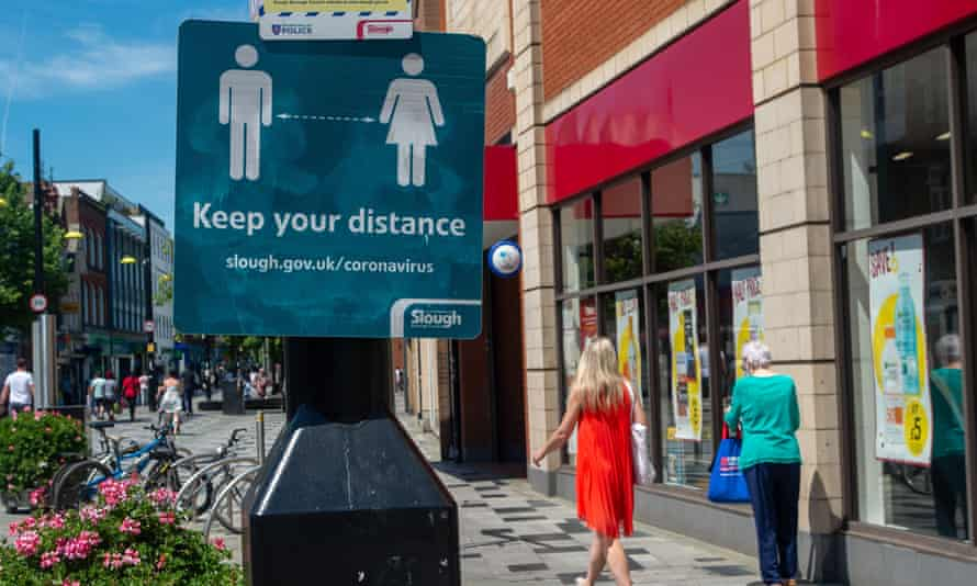 A sign reminding shoppers to stay distanced on Slough High Street.