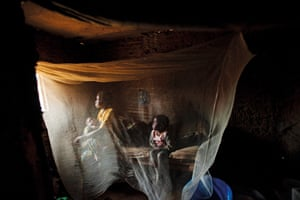 Kahindo, 20, at home with her two children born out of rape in North Kivu Province, eastern Congo, April 2008