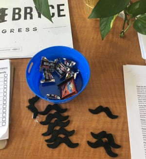 A pile of fake mustaches sit on the table in Randy Bryce's office in Racine.