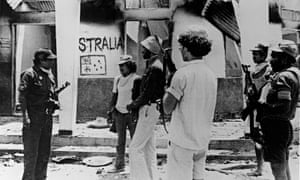 Indonesian troops at the house in which Australian journalists Greg Shackleton and Malcolm Rennie, cameramen Gary Cunningham and Brian Peters, and sound recordist Tony Stewart sheltered before dying while trying to capture images of Indonesian troops as they invaded Balibo in 1975