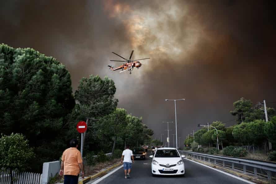 A firefighting helicopter tackles a blaze in a suburb of Athens last year.