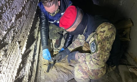 Military police find a gun hidden in the house of a mobster in Foggia during Monday's dawn raids.