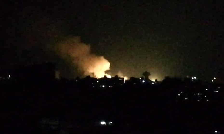 Smoke billows over buildings near the Syrian capital, Damascus, following a reported Israeli airstrike.