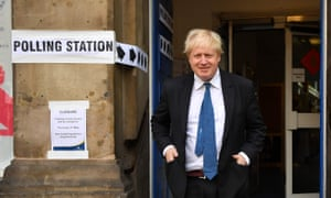 Boris Johnson leaves a polling station.