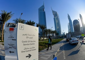 A panel indicates the way to a vaccination centre, set up at the Dubai International Financial Center.