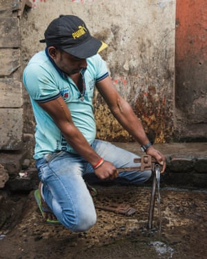 Plumber Ravi Shaw at work on one of the open water pipes
