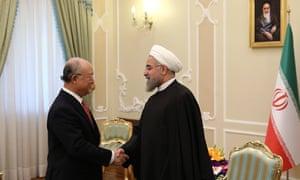 Rouhani meets the International Atomic Energy Agency director, Yukiya Amano, in Tehran.