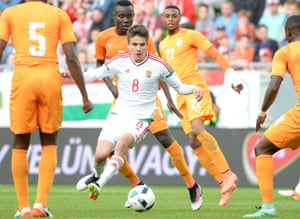 Adam Nagy surrounded by opponents during the recent friendly against Ivory Coast.