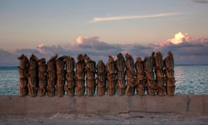 Sandbags line a wall on a causeway on South Tarawa, Kiribati.