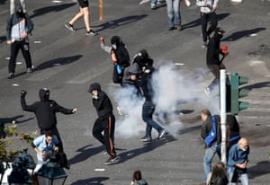 Protesters take cover from exploding tear gas canisters during brief clashes between police and protesters during strike in central Athens<br>Protesters take cover from exploding tear gas canisters during brief clashes between police and protesters during a 24-hour general strike in central Athens, Greece, November 12, 2015. Domestic flights will be grounded, ships will remain docked at ports and public offices will shut on Thursday as Greeks walk off the job to protest austerity measures demanded by international lenders in exchange for fresh bailout funds. REUTERS/Yannis Behrakis