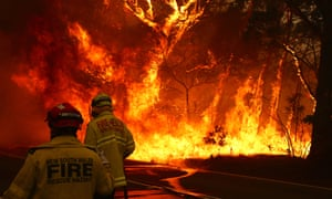 Three firefighters were hospitalised with severe burns after battling bushfires in New South Wales, Australia, on Thursday.