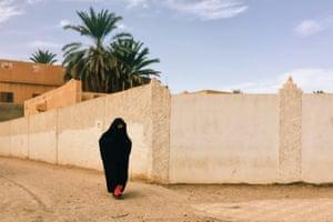 A woman wears a black abaya, Morocco