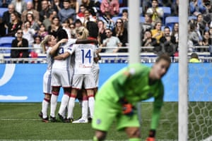 Lyon players celebrate after Marozsan scores their second goal.