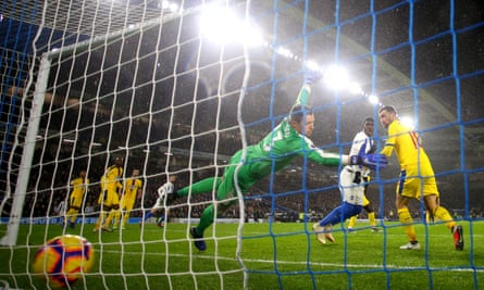 Leon Balogun scores Brighton's second goal and leaves Wayne Hennessey groping at thin air.