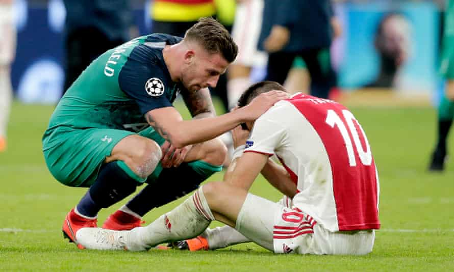 Dusan Tadic is consoled by Toby Alderweireld after Ajax's dramatic defeat by Tottenham.